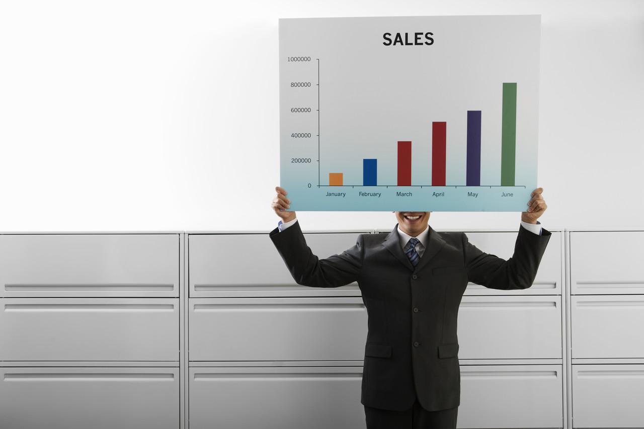 Businessman Holding Graph